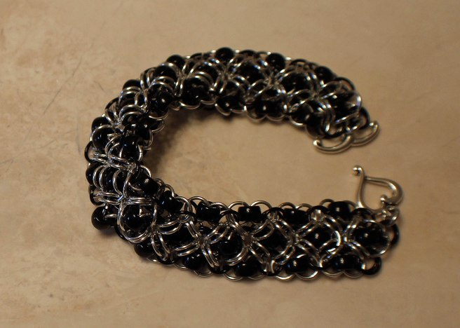 Black beads criss cross chainmaille bracelet