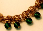 C112a Beaded Dubious weave bronze & green glass bead