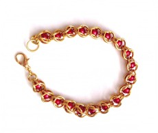 C127 red captured pearl in gold rings