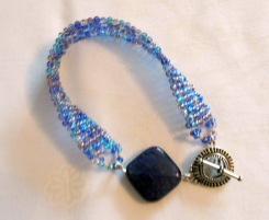 C79 blue seed beads bead weaving bracelet with blue cracked stone and Sp sunburst toggle