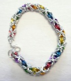 C85 SP and multi coloured aluminium chainmaille rings in byzantine weave bracelet