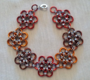 C94 red brown orange alluminium rings japanese flower weave