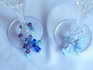page 9 68 two blue glass charms glass & leaf beads